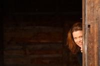 Woman Peeking from behind Wall