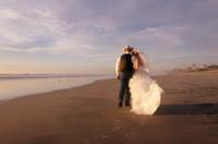 Wedding Couple Walking Down the Beach