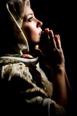 Beautiful praying girl with old russian shawl on head