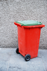 Orange trash bin in the street