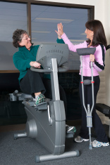 Injured Woman Working Out - Rehab