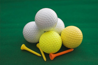 Five Golf Balls and Tees