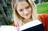 young student with books in the park