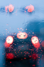 Driving in traffic jam and rain