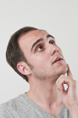 Man thinking away, looking up