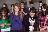 Group of Praying Teenagers, Heads Bowed