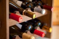 Red wine bottles in rack