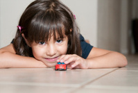 Little Girl Ready to Roll Race Car