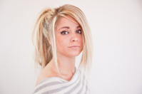 Beautiful Blond Young Adult Has A somber Look