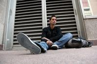 Sad Man Sitting on Street