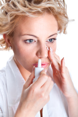 Woman  use an  bronchial inhale