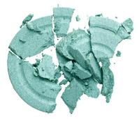 Broken green eye shadow, isolated on white macro