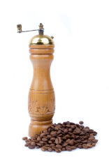 Old coffee-grinder with coffee beans