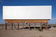 Blank White Billboard in the Desert near a Freeway