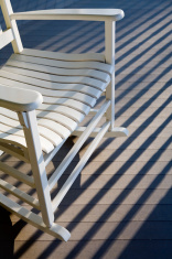 rocking chair on a sunlit porch