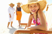 Girl with grandmother and mother enjoying on the beach