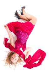 Beautiful girl in red dress sleeping