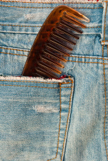 Comb in blue denim texture background.