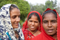 Three working class Indian woman together