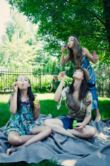 Gipsy cool family blowing soap bubbles.
