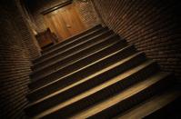 Dark stairs to door