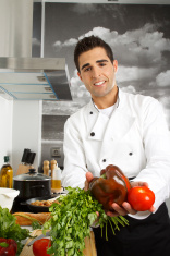 Chef Proudly Show Some Fresh Vegetables