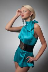 Fashion photo of a blond woman in cyan dress