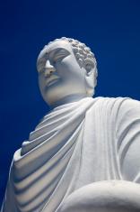 White Buddha Statue on blue sky in Nha Trang, Vietnam