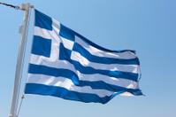 Greek Flag against clear blue sky