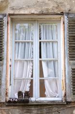 Walking shoes on the window pane