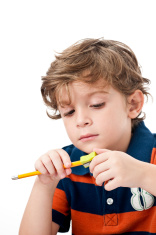 serious kid with pencil and sharpener