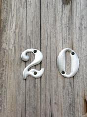 Aluminum Twenty Numerals on a wooden pole