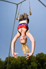Circus Acrobat Hanging Upsidedown