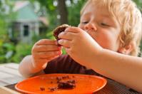 Little boy eating some cake