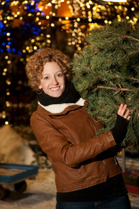 Woman Shopping For Christmas Trees