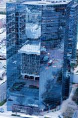 City Reflected In Mirrored Skyscraper