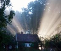 sunrise behind a house