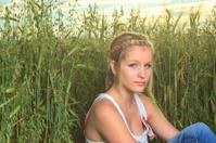 Woman Sit on Green Wheat