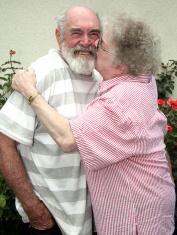 Grandma kissing grandpa
