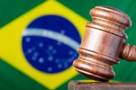 Selective focus image of gavel against Brazil flag