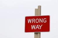Wrong way sign post