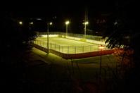 Floodlit soccer field at night
