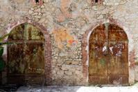Haiti, Jacmel, arched doorways in warehouse.
