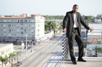 Businessman posing by the ledge