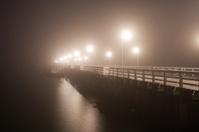Pier in dense fog