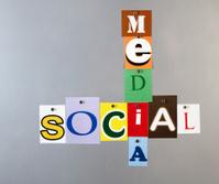 Social media pinned on a silver metal pin board