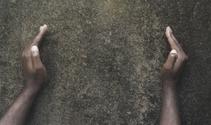 brick wall and hands