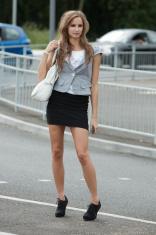 Attractive woman crossing road