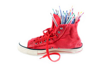 Coloured pens in sneakers.