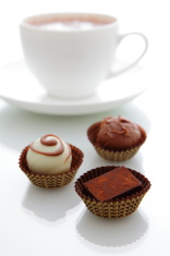 delicious handmade chocolate with a cup of coffee